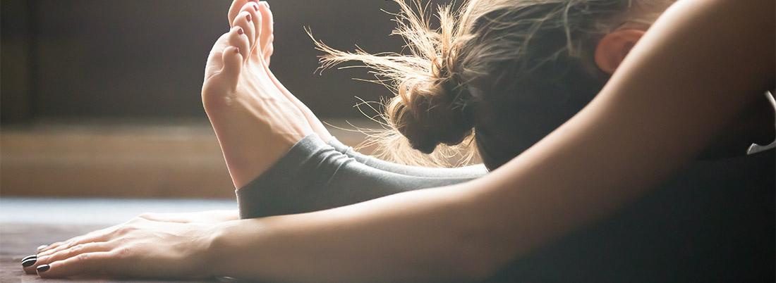 Girl folding over in yoga pose